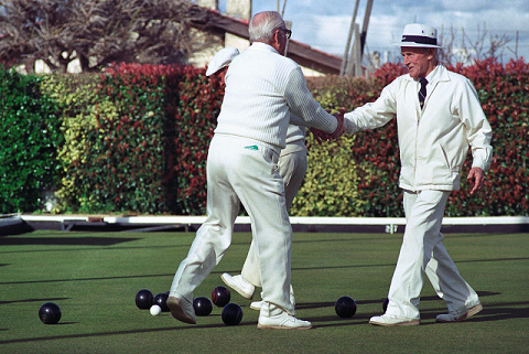 Men playing bowls